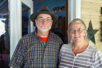 Randy and Joan Green standing outside of their home.