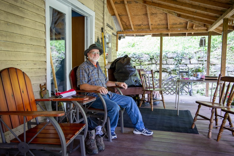 Pastor Randy Green sitting on his front porch in Elkhorn, West Virginia.