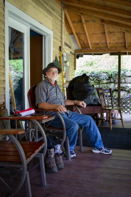 Randy Green, one of the voices heard in Episode One, sits in a rocking chair on his wide front porch in West Virginia