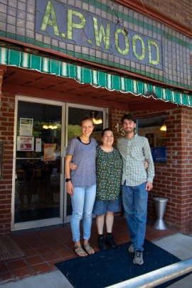 Shifting Climate hosts Michaela Mast and Harrison Horst stand outside of Ya'Sou restaurant with owner and interview subject Markella Gianato