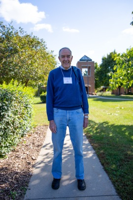 A photo of interview subject Bennett Brabson standing on a sidewalk at Anabaptist Mennonite Biblical Seminary in Indiana. Click here to view the photo essay for episode four of season one.