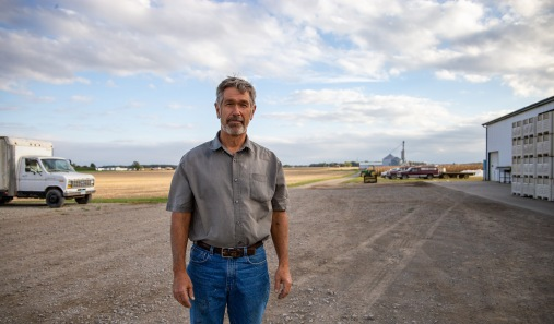 Bob Suter is a vegetable farmer in Bluffton, Ohio. The farm, pictured behind him, has been in Bob's family for six generations.