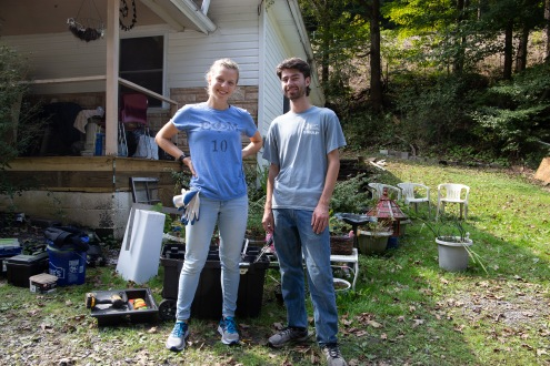 Michaela Mast and Harrison Horst, the Shifting Climates hosts, stand outside of Bobby Redd's home where SWAP (a local volunteer organization) is working on reconstructing his porch.