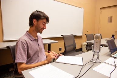Harrison Horst, co-host and producer of Shifting Climates, looks over interview questions before interview with M. Div student Matthew Groves.