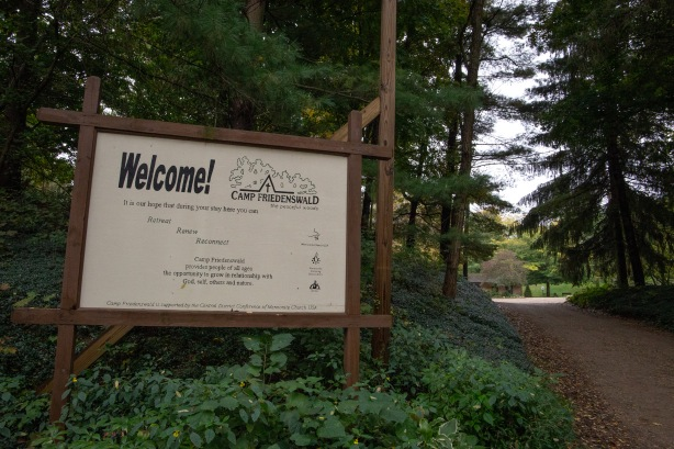 "This sign sits at the entrance to the camp grounds. It reads, ""Camp Friedenswald provides people of all ages the opportunity to grow in relationship with God, self, and nature."""