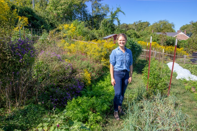 Tallu Schuyler Quinn, Executive Director of the Nashville Food Project (TNFP), stands in one of several gardens started by the organization.