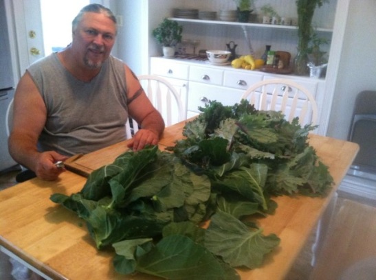 Randy sits with a recent harvest from the farm. (Photo from Randy Woodley)