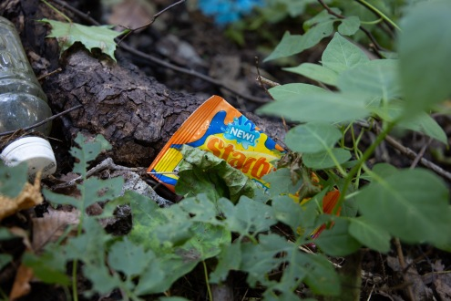 A Starburst wrapper found in the dirt at an illegal dumpsite in Pittsburgh, PA. This site is one that Allegheny Cleanways has cleaned up before, and continues to clean up.
