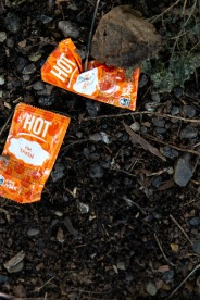 Hot sauce packets seen at an illegal dump.