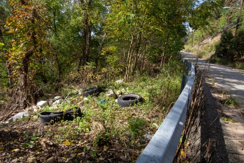 Trash at the bottom of a hill in Gershon neighborhood.
