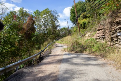 A crumbling road in the Gershon neighborhood in Pittsburgh. Illegal dumps are often found at abandoned sites like this one.