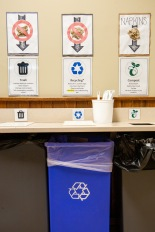 Signs in the camp dining hall explain what items go where in the waste stream.
