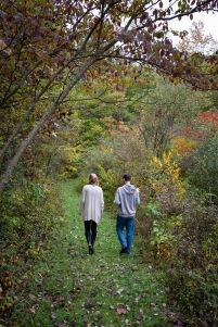"Podcast hosts Michaela Mast and Harrison Horst hike through the ""peaceful woods."""