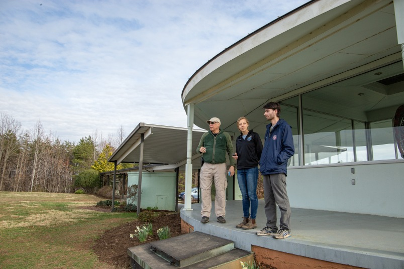 Joseph Jeeva Abbate, director of Yogaville Environmental Solutions (YES), gives a tour of the grounds to Shifting Climates hosts Harrison Horst and Michaela Mast.