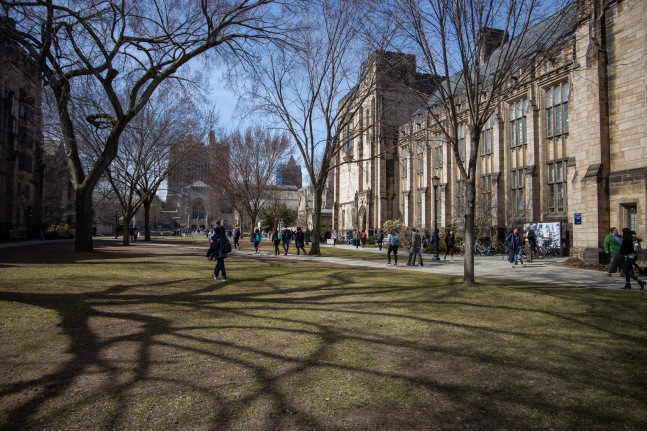 Students mill around Yale's main campus between classes.